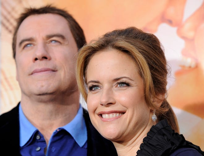 "Kelly Preston and John Travolta attend her movie premiere ""The last song"" In Los Angeles on March 25, 2010."
