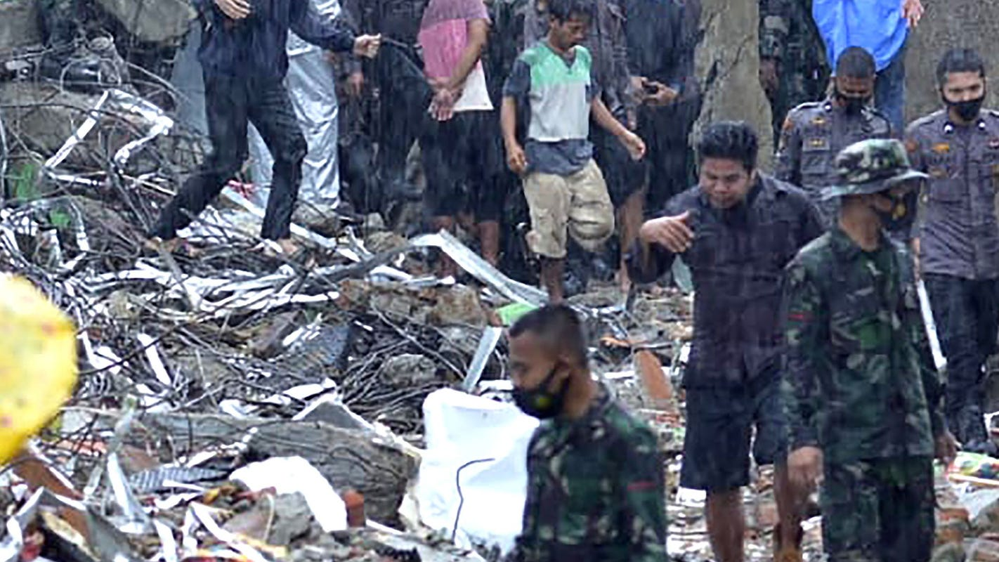 At least 34 people are killed in the Indonesia earthquake, which collapses homes and buildings