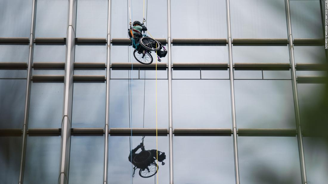 A paraplegic Hong Kong athlete in a wheelchair climbs a skyscraper