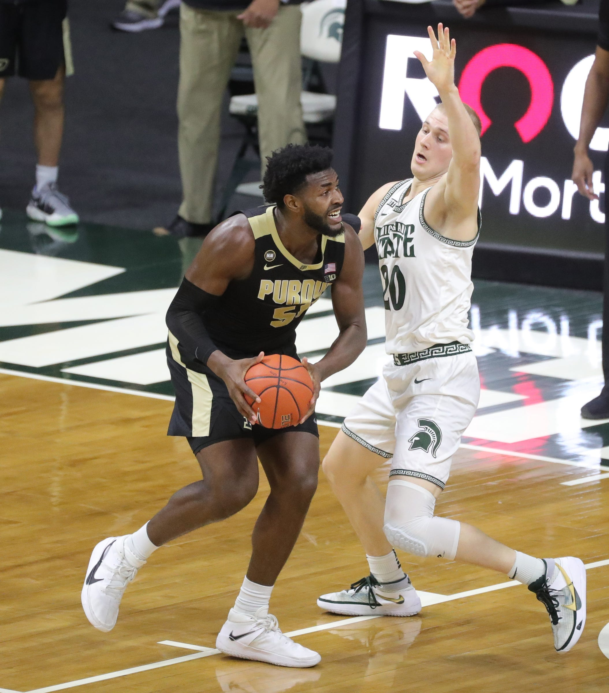 Michigan state striker Joy Hauser defends Purdue Boilermakers Trevion Williams during the second half at Priceline Center in East Lansing, Friday Jan 8, 2021.
